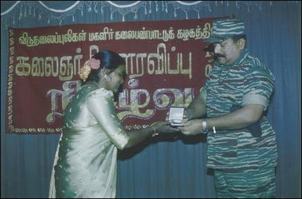 Pirapaharan felicitates women artists.
