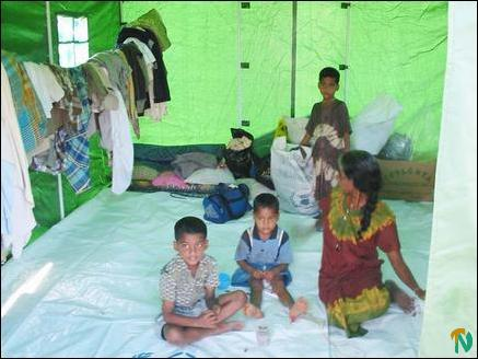 Children sitting inside a tent at Eachchilampathu area in Trinco district