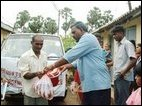 TRO Project Director Mr.Jeha hands over relief package to a railway employee