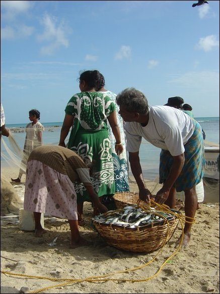 Family members help in sorting the day's catch.