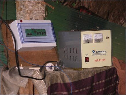 Overload protector switches and a Voltage regulator which serve as the gateway to the supply network are mounted inside his hut. Since power output is manually controlled Radhakrishnan estimates the power need and sets the water flow to the 'desired' level so that the voltage stabilizer is given sufficient range to operate.