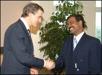 LTTE's Political Head shaking hands with the Norweigan Foreign Minister