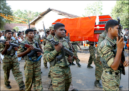 Col. Ramanan's remains buried with military honours in Thandiyady.