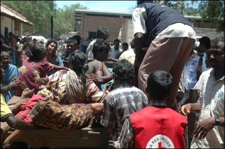 Casualties arriving in makeshift hospital on 06 April, 2009