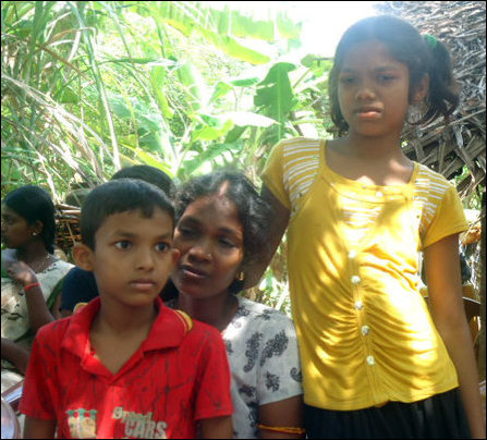 Nakuleswaran's wife, a teacher, and their children photographed by visiting Tamil activists