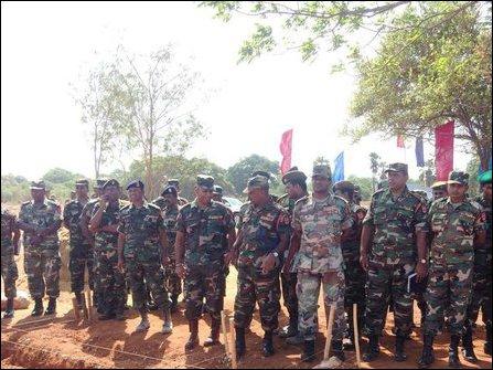 Sinhala soldiers posing for media at Maaviddapuram