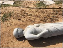 One of the statue fallen in the sand