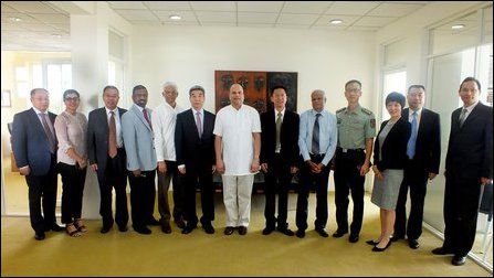 Milinda Moragoda [centre] and Colombage with visiting Chinese officials at Pathfinder Foundation in